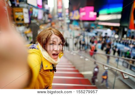 Beautiful Young Woman Taking A Selfie With Her Smartphone On Times Square