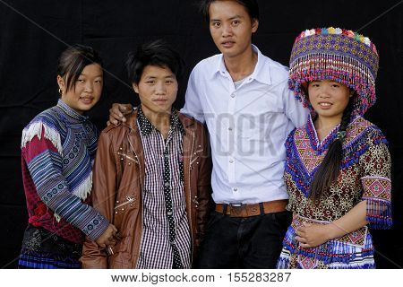 Sin Cheng, Vietnam, October 26, 2016 : Two Couples In Front Of A Black Sheet. Hmong Women Of North V