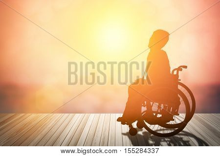 silhouette of disabled on wheelchair or background.day of the disabled person .Concept cripple or disabled on wheelchair.
