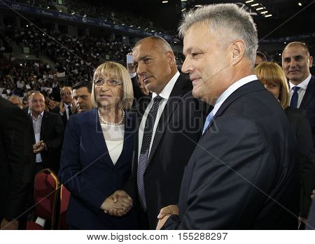 SOFIA BULGARIA - OCTOBER 9: Bulgarian prime minister and head of political party GERB Boyko Borisov (C) greets presidential and vice-presidential candidates Tsetska Tsacheva and Plamen Manushev during launching 2016 Presidential Campaign Oct 9 2016 Sofia