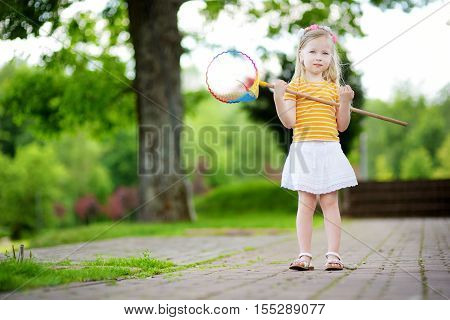Cute Little Girl Catching Butterflies With A Scoop-net