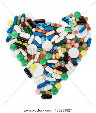 heart from pills and capsules on a white background