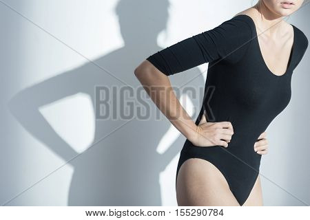 Woman Waering Holding Her Stomach