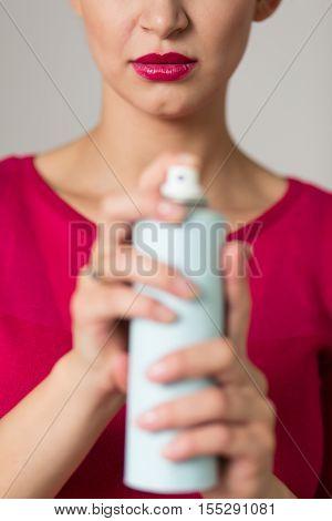 Woman Holding A Bug Spray