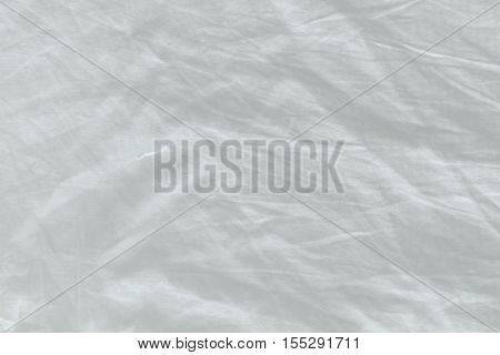 Unmade bed sheet texture top view as abstract texture or displacement map