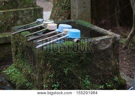 water well and brass in front shrine in koyasan Wakagama Japan