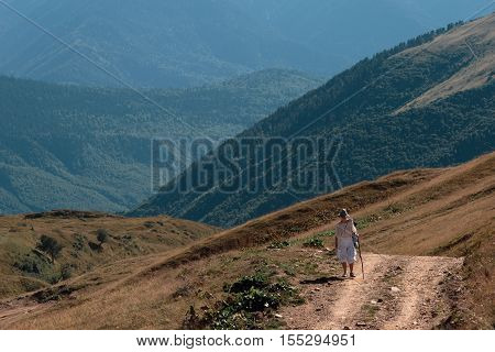 A woman traveling in the mountains, going ahead to the heights.
