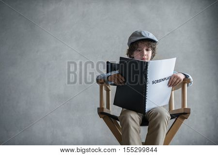 Little boy with a screenplay
