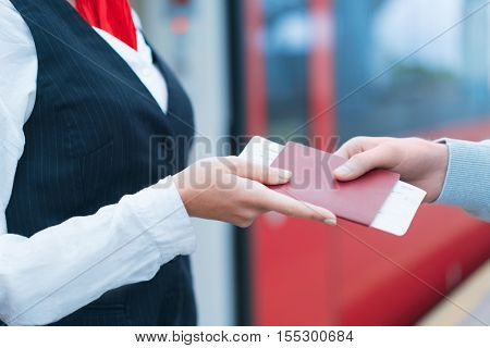 Woman's hands with a passport at station