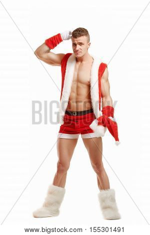 Confused fitness santa isolated on white background. Embarrassed fitness santa. Sexy Santa Claus. Bodybuilder Santa with red box on a white background.