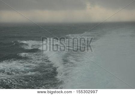 Storm on the Java sea. Indonesia. Heavy rain and overcast sky.