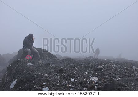 Climbing the volcano Semeru Indonesia. Crater covered with debris and slag