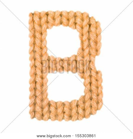 Letter B alphabet on a blurry texture knitted pattern of woolen thread closeup. One letter of the English alphabet. Education and holidays. Typography design. Color orange