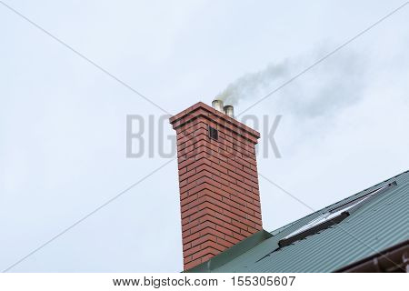House Chimney With Flying Smoke