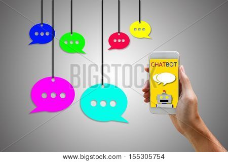 Chatbot concept. Man holding smartphone and using chatting.
