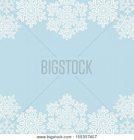 Christmas card with white lace snowflakes borders on blue background
