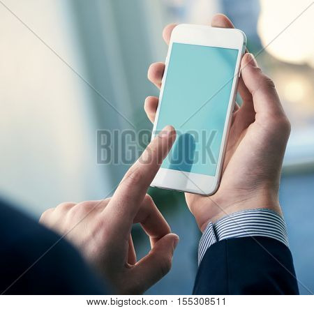 Smartphone device mockup in male hands. Clipping path