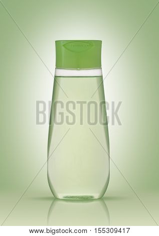 Shampoo in a plastic bottle on a green background with reflection. The concept of purity and health.