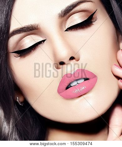 High fashion look.glamor closeup beauty portrait of beautiful Caucasian young woman model with bright makeup with perfect clean skin with colorful red lips