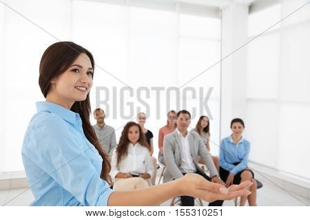 Business trainer giving presentation to group of people
