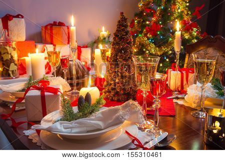 Free place at the Christmas table with burning candles