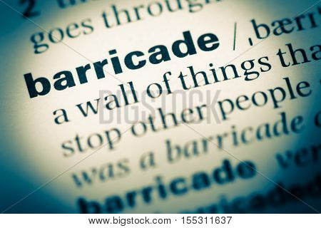 Close Up Of Old English Dictionary Page With Word Barricade