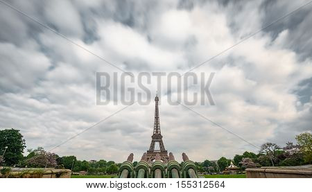 Long shot of The Eiffel Tower in Paris, France. Cloudy sky