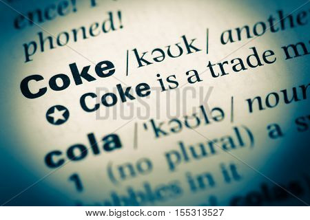 Close Up Of Old English Dictionary Page With Word Coke