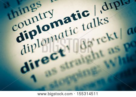 Close Up Of Old English Dictionary Page With Word Diplomatic