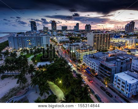 Aerial view of illuminated Ocean Drive and South beach, Miami, Florida, USA.