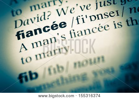 Close Up Of Old English Dictionary Page With Word Fiancee