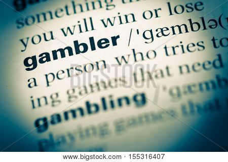 Close Up Of Old English Dictionary Page With Word Gambler