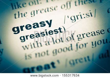 Close Up Of Old English Dictionary Page With Word Greasy