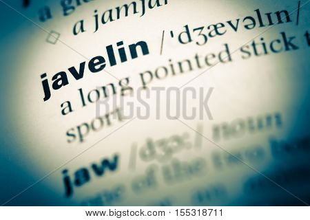 Close Up Of Old English Dictionary Page With Word Javelin