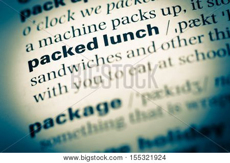 Close Up Of Old English Dictionary Page With Word Packed Lunch