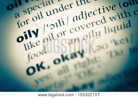 Close Up Of Old English Dictionary Page With Word Oily