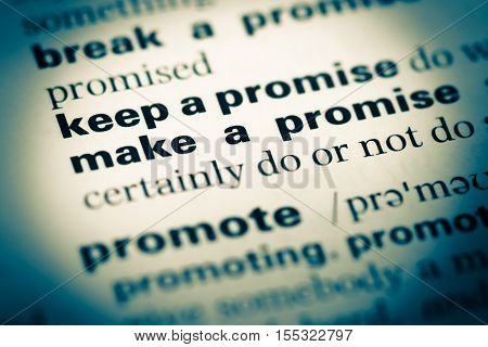 Close up of old English dictionary page with word keep a promise poster