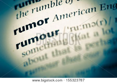 Close Up Of Old English Dictionary Page With Word Rumor