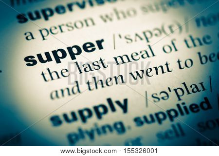 Close Up Of Old English Dictionary Page With Word Supper
