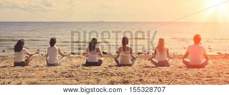 Image of a group of people sitting on the beach