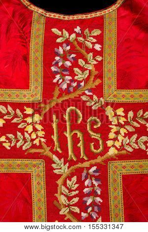 Closeup of a red antique chasuble of 150 years old
