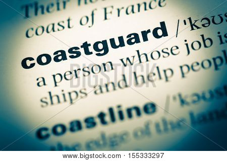 Close Up Of Old English Dictionary Page With Word Coastguard