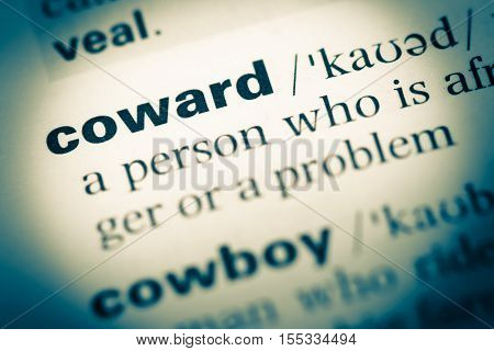 Close Up Of Old English Dictionary Page With Word Coward