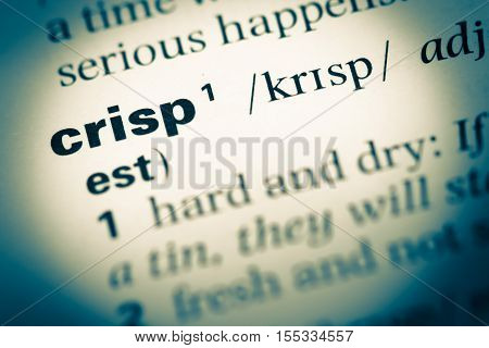 Close Up Of Old English Dictionary Page With Word Crisp
