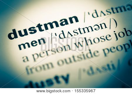 Close Up Of Old English Dictionary Page With Word Dustman