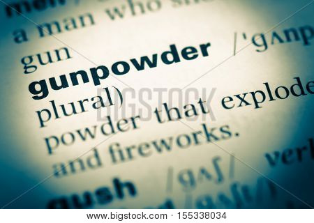 Close Up Of Old English Dictionary Page With Word Gunpowder