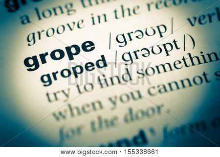 Close Up Of Old English Dictionary Page With Word Grope
