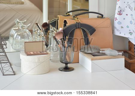 Make Up Items And Leather Bag On Dressing Table