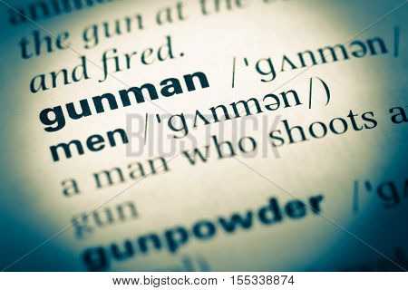 Close Up Of Old English Dictionary Page With Word Gunman