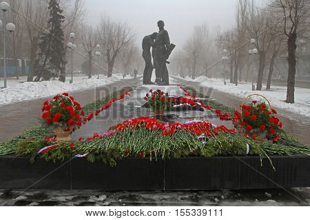 Volgograd Russia - February 03 2013: Red carnations assigned to the monument to Komsomol members in Volgograd. Event dedicated to the celebration of Victory Day in the battle of Stalingrad. Authors: sculptor A.Y. Krivolapov and architect V.P. Kalinichenko